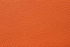 Nahaufnahme der nahtlosen orange ledernen Beschaffenheit Lizenzfreies Stockbild