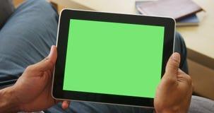 Nahaufnahme der Tablette mit greenscreen Stockbilder