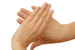 Nahaufnahme der weiblichen Hand gestikulierend, während Sie auf Weiß lokalisiert werden Stockbild