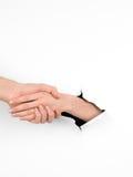 Handerschütterungsgeste, Papier mit Loch stockfotografie