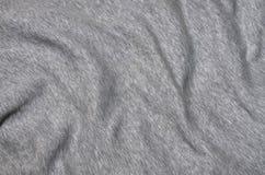 Nahaufnahme der zerknitterten Heizung und des gestrickten Sporttrikots oder des Hoodiegewebes maserte Stoffhintergrund mit empfin stockfoto