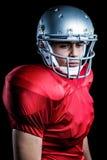 Nahaufnahme des überzeugten Spielers des amerikanischen Fußballs Stockfotos