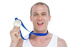 Nahaufnahme des Athleten mit olympischer Medaille Lizenzfreies Stockfoto