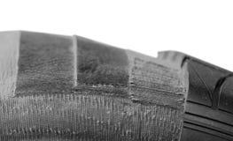 Nahaufnahme des Autoreifens schneiden-durch Stockbilder