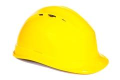 Nahaufnahme des gelben Schutzhelms auf weißem Hintergrund Stockbilder