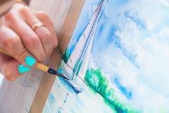 Nahaufnahme des Künstlers zeichnet Stockfotos