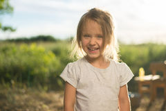 Nahaufnahme des lachenden Kindergesichtes Stockfotografie