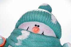 Nahaufnahme des lustigen Gesichtes des Schneemannes Stockbild