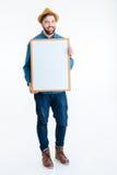 Nahaufnahme des Mannes übergibt das Zeigen des weißen leeren Brettes Lizenzfreie Stockfotografie