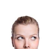 Nahaufnahme des oberen Teiles eines neugierigen womans Gesichtes Stockbilder