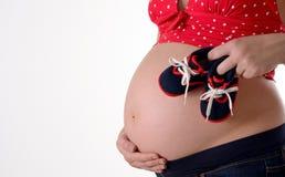 Nahaufnahme des schwangeren Bauches Stockbild