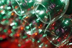 Nahaufnahme des Weinglases mit abstrakten Leuchten Lizenzfreies Stockfoto