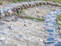 Nahaufnahme des Zement- und Felsenschritthintergrundes Stockfotos