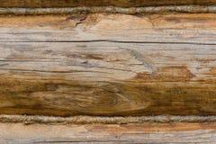 Nahaufnahme einer alten hölzernen Wand hergestellt von den Klotz lizenzfreie stockfotografie