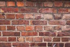 Nahaufnahme einer alten verwitterten Backsteinmauer Stockfotografie