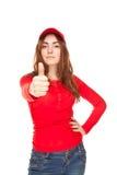 Nahaufnahme einer jungen Frau, die sich Daumen zeigt Stockfoto