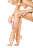 Rasieren der Beine Stockbild