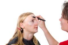 Nahaufnahme eines Maskenbildners, der Make-up anwendet Stockfoto