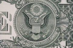 Nahaufnahme eines Vogelsymbols auf dem Dollar Lizenzfreies Stockbild