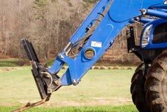 Nahaufnahme haylifter auf Traktor Lizenzfreie Stockfotos