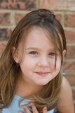 Nahaufnahme-Portrait eines lächelnden Mädchens Stockbilder