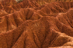 Nahaufnahme Sand-Steinfelsens der Dürre des roten orange Stockfotografie