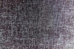 Nahaufnahme-schwarze Farbsynthetische Gewebe-Beschaffenheit - Muster-Design oder Polyester-materieller abstrakter Hintergrund stockbilder