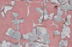 Nahaufnahme verwitterte und befleckte veraltetes rosa Betonmauer textu Lizenzfreie Stockfotografie