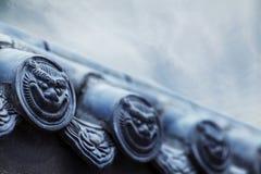 Nahaufnahme von Carvings auf dem Dach der Pagode Lizenzfreie Stockfotos