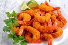 Nahaufnahme von panierten Fried Shrimp-Endstücken Lizenzfreie Stockfotografie