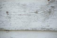 Nahaufnahme von Schmutzweiß malte Bretter, die und w beunruhigt werden stockfotografie