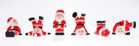 Nahaufnahme von sechs lustigen Santa Claus-Zahlen in Folge Stockbilder