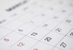 Nahaufnahme von Zahlen auf Kalenderseite Lizenzfreie Stockfotos