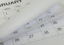 Nahaufnahme von Zahlen auf Kalenderseite Stockbild