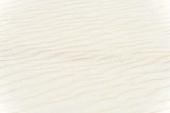 Strukturierter Hintergrund des weichen Sandes. Beige Farbe. Lizenzfreies Stockbild