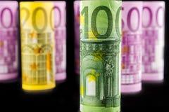Nahaufnahmeansicht Euro gerollter Banknote 100 Stockfotografie