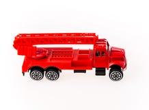Nahaufnahmeautospielzeug auf weißem Hintergrund Stockfoto