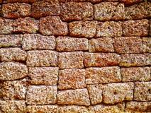 Nahaufnahmebeschaffenheit der ungleichen Backsteinmauer stockfoto