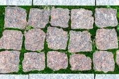 Nahaufnahmebeschaffenheit, Hintergrund des Pflastersteins blockiert unterschiedliche Beschaffenheit Stockbilder