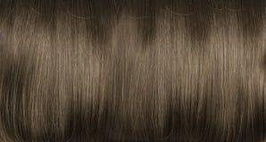 Nahaufnahmebild der dunklen, dichten, geraden Frisur Stockbilder