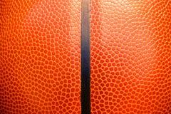 Nahaufnahmedetail des Basketballball-Beschaffenheitshintergrundes Lizenzfreies Stockbild