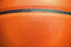 Nahaufnahmedetail des Basketballball-Beschaffenheitshintergrundes Stockfotos