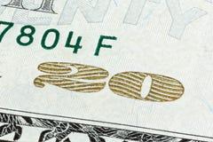 Nahaufnahmeende gestapelt vom 20 Dollarschein lokalisiert auf einem weißen backg Lizenzfreies Stockbild