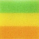 Nahaufnahmefarbschwämme für Abwasch, abstrakter Hintergrund Lizenzfreie Stockbilder