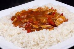 Süßes und saures Huhn mit Reis. Stockfotos