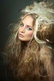 Nahaufnahmefrau mit dem Haar lang. Stockbilder