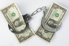 Nahaufnahmehandschellen und -geld Stockfotografie
