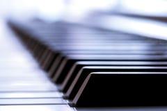 Nahaufnahmemakro eines Klavierschlüssels Lizenzfreies Stockfoto
