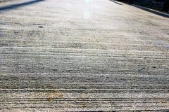 Nahaufnahmemuster der Betonstraßeoberfläche stockfotos