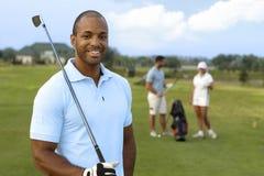 Nahaufnahmeporträt des hübschen schwarzen Golfspielers Stockbild
